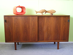 """Vintage Florence Knoll Petite Credenza, in walnut with slider doors and open storage inside. Retains original black leather pulls.  Oak interior with  adjustable/removable shelves. This piece was produced in 1969 Overall good condition, needs some a little TLC, faint ring on the top.  Measurements: 48""""W x 27 1/2""""H x 18"""" D  Free Shipping in the continental US. - SOLD"""