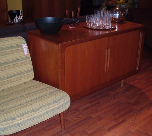 """Solid teak credenza; very unique, with rounded edges and tambour doors.  Great wood detail on handles.  Slider shelf, perfect for turntable, DVD etc 48"""" x 19"""" deep - SOLD"""