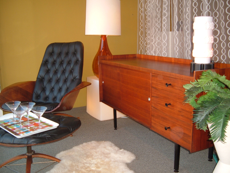 """Fabulously stylized,  """"thin edge"""" rosewood and teak credenza attributed to George Nelson's design  for Herman Miller. Back side is finished; with black metal square tubular legs and drawer pulls add to finish off these clean modern lines.  SOLD"""