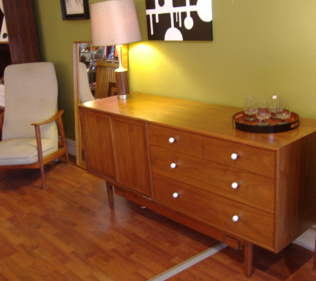 American modern credenza/dresser in walnut by Drexel, ample storage in exposed drawers with additional deep drawers behind double door panels.  Secret trundle at bottom added post mfg. SOLD