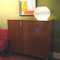 """In the style of Gio Ponti, this Italien style hi-boy credenza in italien walnut, has tapered legs and lots of open space storage inside with removable shelves and two accoutrement drawers   52""""L x 17""""D x 44 3/4""""H - SOLD"""