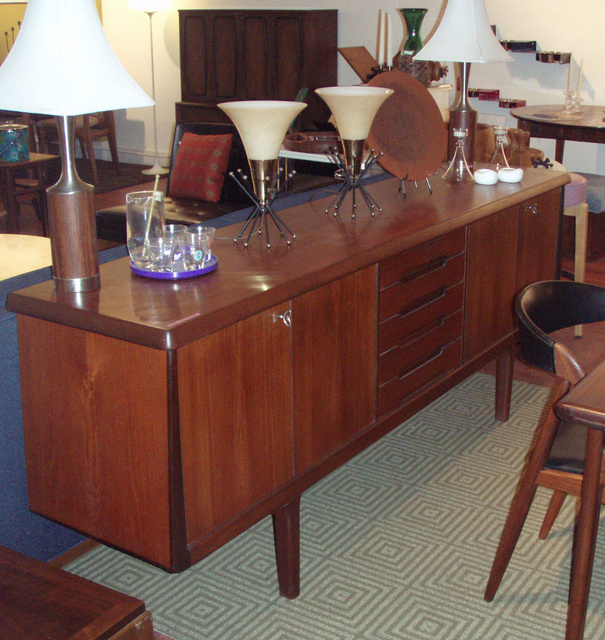 """Teak credenza with center bank of felt lined drawer and flanking double door storage on each side. 81""""L X 18"""" D X 31"""" H retains keys,  Shipping to NY or Florida $390.00 including insurance and white glove delivery!   - SOLD"""