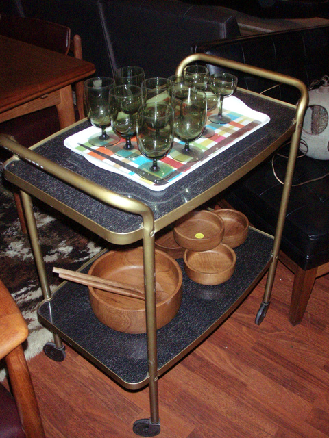 1950's atomic, hostess cart/traveling bar, with two tier, easy glide wheels and maintenance free black laminate surface.  - SOLD