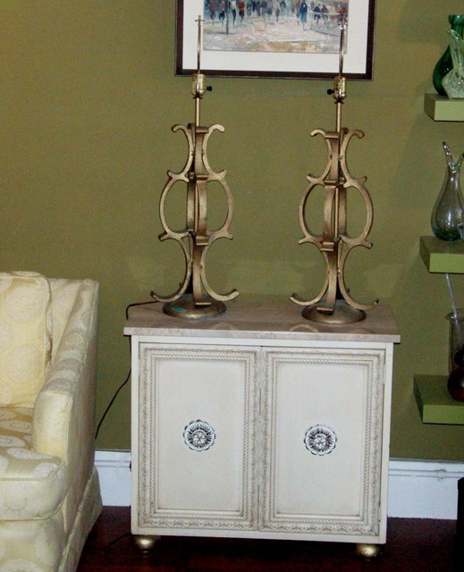 Hollywood Regency/Baroque console with travertine top and storage w/ removable shelf behind doors-great ornamentation, carving and gilded feet.  Pair Hollywood Regency gold, cast metal lamps(heavy) SOLD