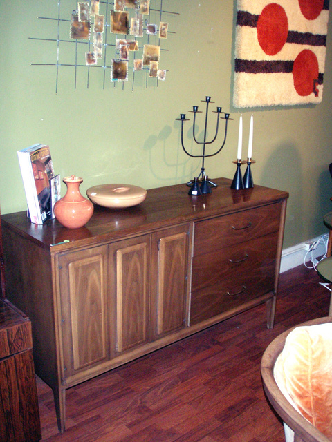 Vintage danish modern walnut credenza w/ drawers and swing out door.