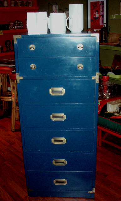 """Hollywood Regency at its best, this elegant campaign style dresser with its brass hardware is all original in KLM blue, needs a little TLC or complete makeover in red, white or black lacquer-you decide:  22""""w x 16"""" D x 52' tall   - SOLD"""