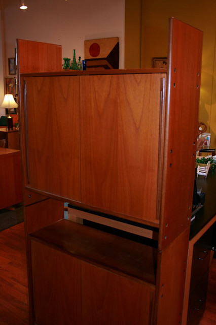 Stackable teak bookcase with sliding doors and adjustable shelves.  Can also be used with both pieces side by side instead of stacked.  $450, SALE $399.00