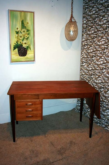 teak danish modern desk with 3 drawers and sliding desk top with leaf.  24 inches deep, 63 inches long with leaf, table top is 47 inches with leaf hanging down, but piece takes up a 48 inch footprint with the leaf hanging down because of the amount it juts out.  $495