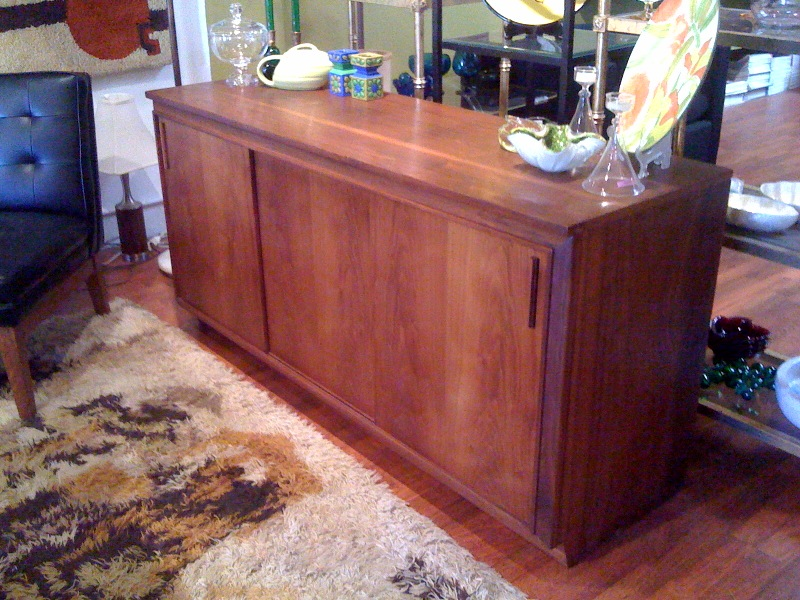 walnut credenza with sliding doors.  beautiful wood grain, great handles.  58.5 inches long by 18.5 inches deep by 28.5 inches tall.   $1250