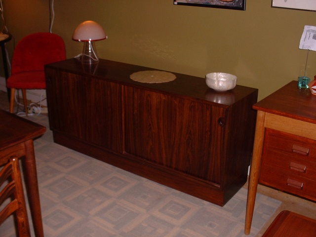 "Brazilian Rosewood Credenza with sliding doors and shelves inside, for great storage, stereo, or DVD player. This piece has clean lines! 59 2/8L x 15 3/4""D x25 1/4""H - SOLD"