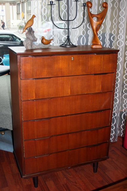 taller teak dresser with great wooden handle detail.  beautiful warm wood tones.  $595