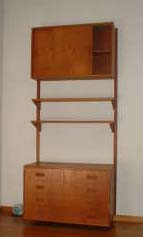 "Vintage teak wall unit 33"" wide, cantilevers off the wall in the style of CadoSystem: pair of stretchers that support 1 cabinet at top has slider doors and shelf, lower cabinet with two DEEP drawers 