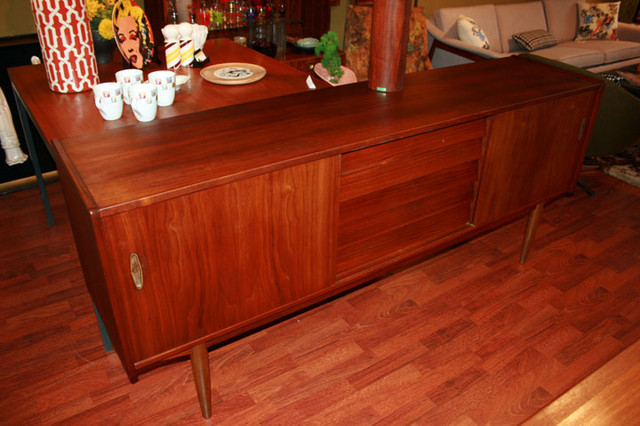 Vintage Danish modern Hugo Troeds teak credenza.  Designed in 1954-55 in Sweden.  Drawers in the center, bookended by two cabinets with adjustable shelves.  17.5 D x 75 W x 32 H  $1500