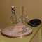 Set of 8 Vintage Capis Shell Placemats, $60.00;  Pyrex Carafe, clear glass $38.00; Pyrex Carafe with wonderful caning detail $45.00