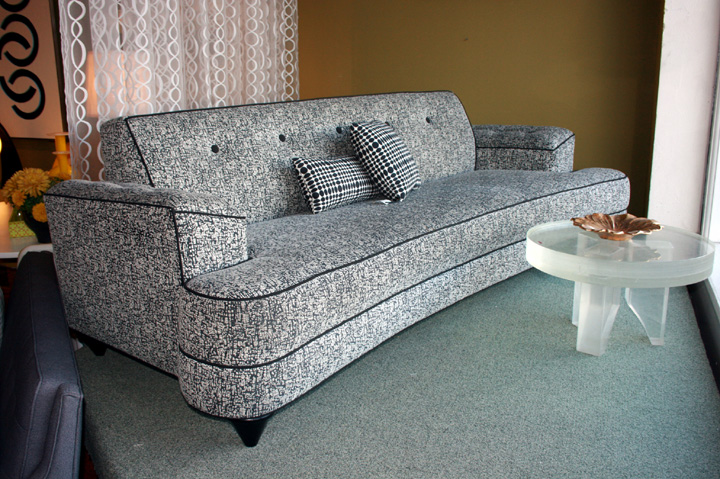 Fabulous 1950's Style Dog Bone sofa in neutral Charcoal-black and white textural fabric with