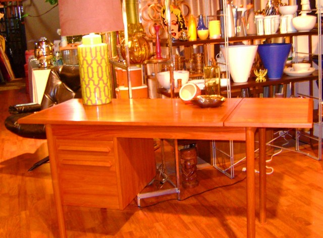 Danish modern teak desk with drop down leave and drawers for storage. $695.00 SALE $550.00
