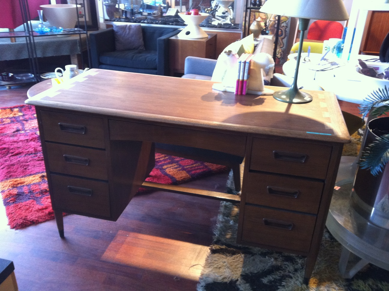 Beautiful midcentury desk by Lane.  Features seven drawers, great wood pulls, and iconic dovetailing detail on the top.  Measures 50 inches wide, 23 inches deep and 29 inches tall.  $695  SKU# F0079