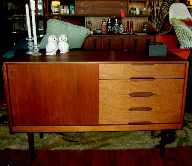 Mid Century Danish teak credenza, tapered legs. 50 inches wide, 17 inches deep, 31 inches tall.$1495.00 SALE $1150