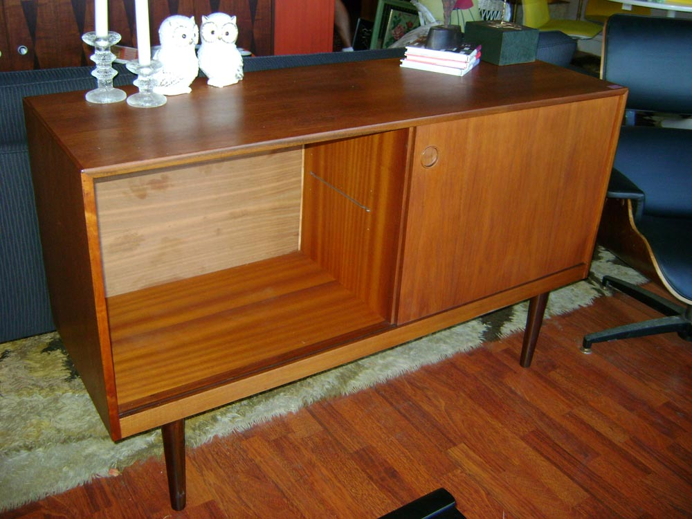 Mid Century Danish teak credenza, tapered legs. 50 inches wide, 17 inches deep, 31 inches tall. generous storage behind slider