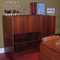 This teak wall-unit, can be used as a desk or as a bar.  There is ample storage for bottles/glasses/accoutrements or miscellaneous task space for a laptop & more!  The drop down desk-top/bar is a great spacesaver. Close it & its contents disappear!