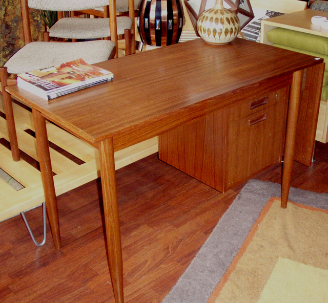 Unique teak slider extention desk in danish modern style- this desk feature a bank of drawers on the right for ample storage and a drop down leaf lifts up to slide over base and extend the desktop when you need a larger workspace! In mint condition $750.00