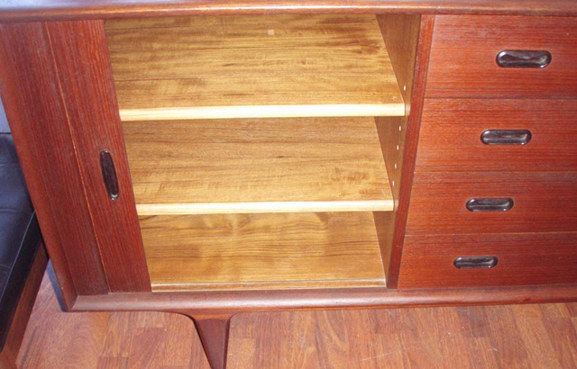 left compartment of open storage w/ 2 removable shelves
