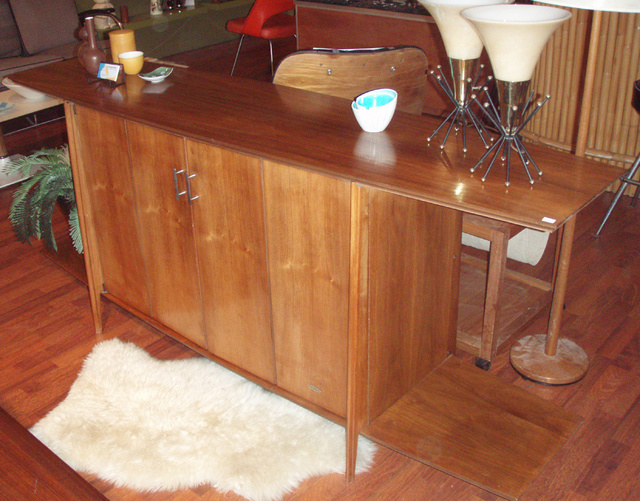 ****ON HOLD***7/17 Mid Century modern vintage, walnut credenza or entertainment center. pair of swing out doors to hide your audio equipment or china.  Elegantly styled the cabinet itself is sleek yet functional-perfect below your flat screen TV! $1295.00  (SALE 995.00) )****ON HOLD***7/17  SHIPPING within the Continental USA-if purchased by 5/27/07 is $250.00