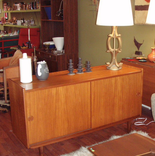 """Vintage mid century modern danish teak credenza/ buffet; perfect for storage with is 2 slider doors. Measures:  54 1/2""""W x 29 3/4""""H x 17""""D.  $1395.00 (SALE$ 1100.00) - SOLD"""