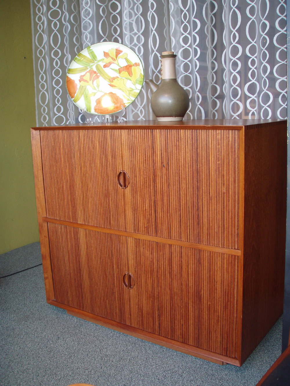 """Peter Hvidt & Molgarrd-Nielsen Teak Cabinet;Solid teak with visible dovetailed joints to cabinet frame. Solid teak pulls. Tambour doors conceal adjustable shelving.it is in excellent condition Purchased in 1961 from Illums Bolighus, Copenhagen. 36""""W x 19""""D x 34"""" H Price $3500.00"""