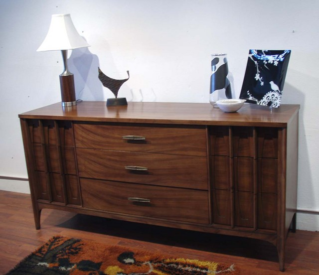 """Kent Coffey Dresser and mirror $695.00 in walnut 64""""L x 19""""D x 31""""H, removable mirror 28.5""""w x 47""""t (available, not shown) 9 drawers center bank of drawers 32""""wide left and right bank of drawers 15.5""""wide $695.00"""