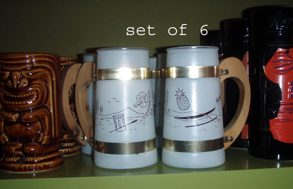 Set of old stock never used Sieta ware muygs, in white w/ painted outrigger , pineapple, hawaiian motif $65.00