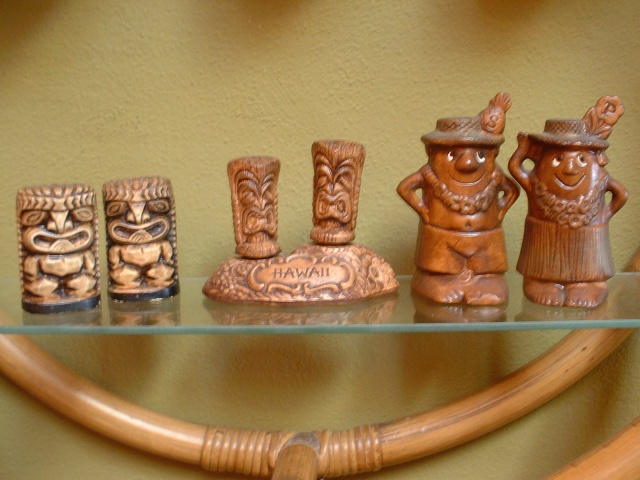 "Vintage Salt n'Pepper Sets Tiki Style (as shown left to right). Vintage, Classic ""KU"" Tiki God shaker set,with original Japan label, never used, approx 3""H $48.00;   Vintage, Treasure Craft Tiki Totem shaker set, totems are 2-sided and sit atop a base, stamped TC on bottom, approx 5""W x 4""H  $85.00   Treasure Craft MR Salt & MRS Pepper, complete with stoppers $85.00 approx 5""H"