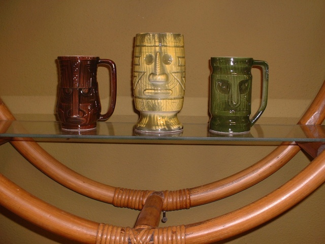 "Vintage Westwood Tiki's.  As shown left to right: 1) Dark Brown Westood Tiki 4 5/8""H $45.00ea;  2) Lime Green Westwood Tiki 5 3/4""H $65.00ea; 3) Dark Green Westwood Tiki 4 5/8""H $45.00ea  ***all Westwood Tiki's are marked on bottoms***