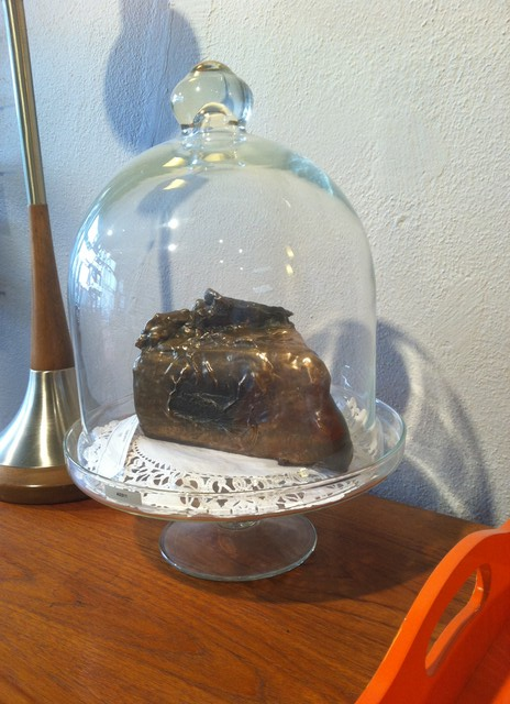 """""""Chocolate Cake"""" by Michael Maes  Solid bronze sculpture of a slice of chocolate cake by local Oakland artist, Michael Maes.  2007. Please contact Michael Maes for 510.290.1397  SKU# A0311"""