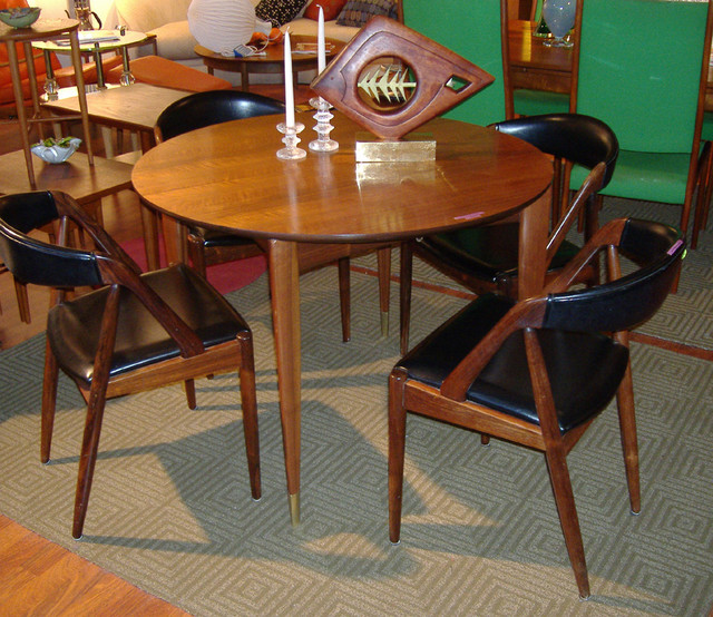 """Italian walnut table by Gio Ponti for Singer and Sons 40"""" dia  $5000  Set of 4 rosewood chairs by Kai Christiansen - CHAIRS ARE SOLD  SKU# F0034"""