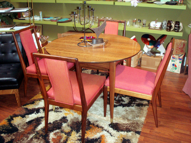 """Gio Ponti dining table for Singer & Sons  40"""" dia Giordano Chiesa Italy, c. 1950 italian walnut, brass 40 dia x 29 h inches $5000  SKU# F0034   set of (4) walnut side chairs designed for Metropolitan furniture by Milo Baughman. SOLD"""