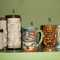 """1. Vintage Paul Marshall products (Japan): Tall tiki mug,PMP stamped on bottom, approx 7""""H  $21.00 (4 available)  2. short coffee mug with original Paul Marshall foil lablel, Japan  approx 4 1/2""""H $35.00 (1 available)  3. Vintage Peanut tiki  4. Vintage handpainted tiki mug-  5. Ku high fire glaze-  we are updating our website, please email sales@retroathome.com for more information on these items."""