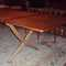 """Vintage Hans J Wegner dining table. """"Custom-size"""", teak drop-leaf top on oak scissor/saber legs with brass supports.  Designed/Signed by Hans Wegner and mfg. in Denmark by Andreas Tuck in 1952 Dimensions: 123"""" x 41 1/2"""" x 28 1/4"""" Height (open).  (2) 24"""" drop leafs    SKU# F0012"""