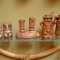 """Vintage Salt n'Pepper Sets Tiki Style (as shown left to right). Vintage, Classic """"KU"""" Tiki God shaker set,with original Japan label, never used, approx 3""""H $48.00;   Vintage, Treasure Craft Tiki Totem shaker set, totems are 2-sided and sit atop a base, stamped TC on bottom, approx 5""""W x 4""""H  $85.00   Treasure Craft MR Salt & MRS Pepper, complete with stoppers $85.00 approx 5""""H"""